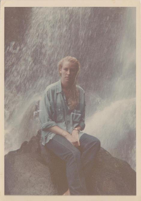 Nancy Johnson at eighteen at Waipiʻo after a swim in a cold mountain pool. She is wearing a blue chambray shirt, called a Kauaʻi shirt, once favored by workers on the plantations, which we wore on all adventures, particularly fluming and ti-leaf sliding.