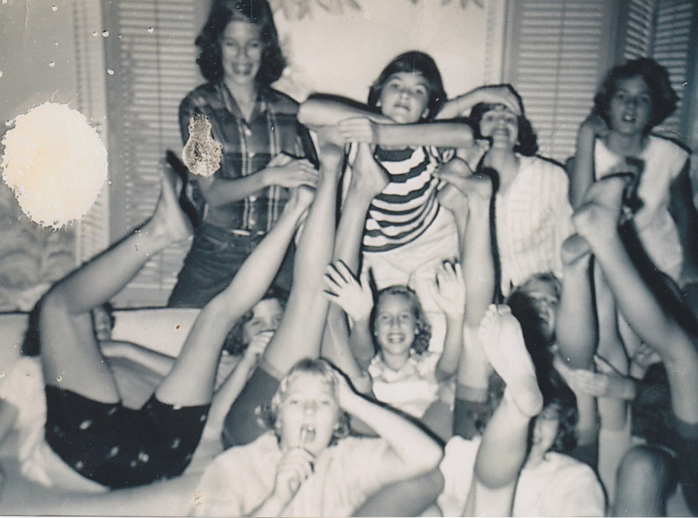 A slumber party in Manoa, circa 1954, to celebrate Nancy's birthday. The friend with whom I swim at Mahukona is standing far left. I am in the middle in a striped t-shirt, above Nancy, whose two hands are raised in front of her. We seem to be wearing lipstick.